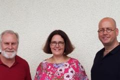 Die Dozenten Mark Merritt und Jutta Bachmann mit Kreisvorsitzendem Jochen Lorenz